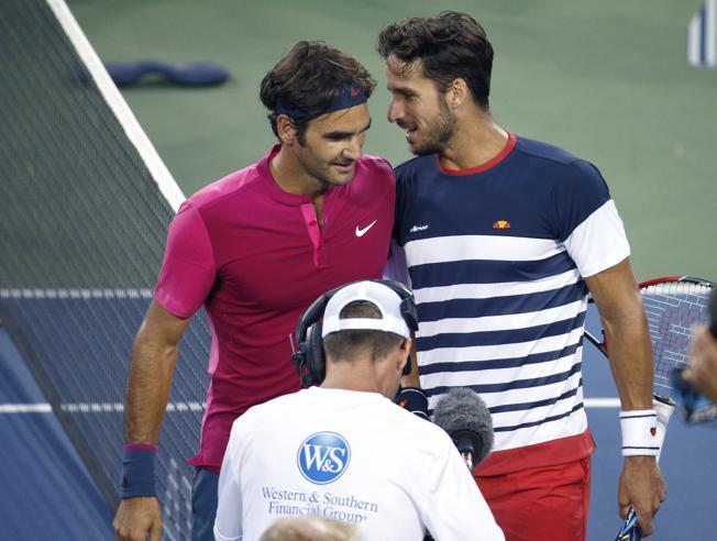 Roger Federer y Feliciano López. Fuente: AP/John Minchillo
