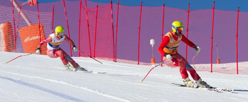Jon Santacana y su guía, Miguel Galindo, durante una competición de esquí alpino. Fuente: Esquia2